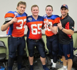 Peter Kilberg,  Chae-Cody Faickney and  Jeremy McLean Community coach and VMFL Spring Flag coordinator, Doug Pauls